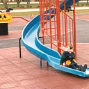 Rubber covering for children playgrounds