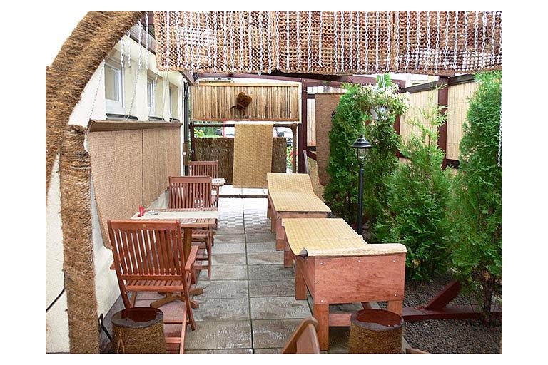 Bathhouse with an outdoor terrace and bar